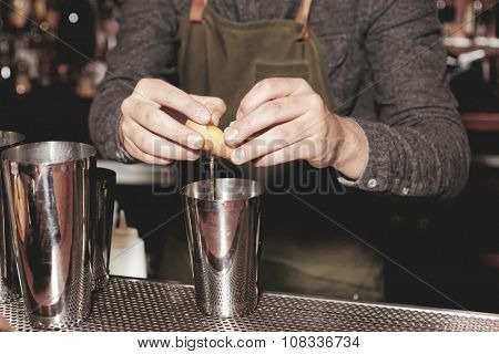 Bartender is adding egg white to shaker