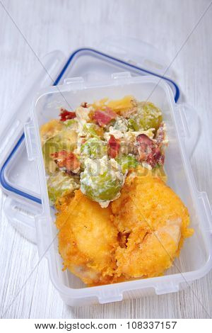 Lunch box with russel sprout casserole and fried chicken