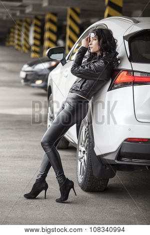 Beautiful Female Model Standing At A White Car In Sexy Pose
