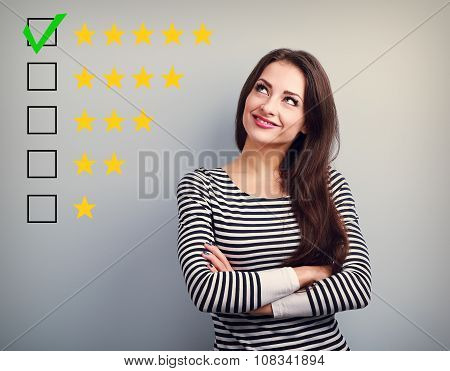 The Best Rating, Evaluation. Business Confident Happy Woman Voting To Five Yellow Star To Increase R