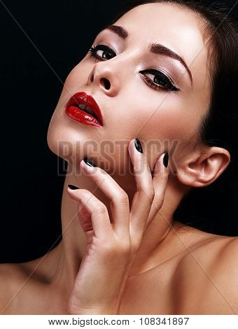 Beautiful Makeup Woman With Bright Red Lips And Black Manicured Nails On Black Background. Closeup P