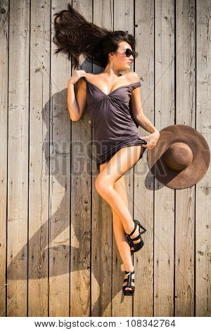 beautiful model lying on wooden floor