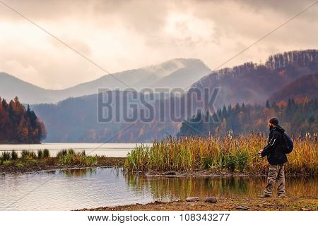 Fisherman On A Lake In Autumn