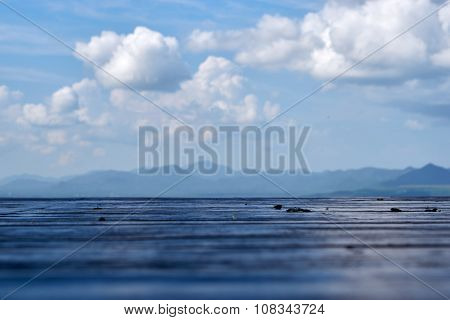 Wood Floor With Mountain And Cloud Background