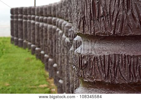 Cement Pole In Wood Like In Curve Line