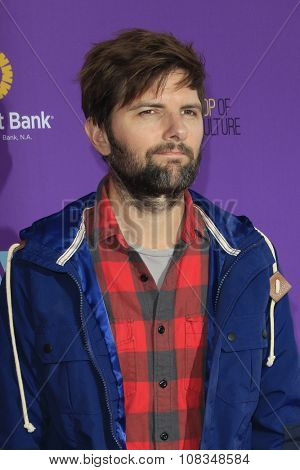 LOS ANGELES - NOV 15:  Adam Scott at the Express Yourself 2015 presented by P.S. ARTS at the Barker Hanger on November 15, 2015 in Santa Monica, CA