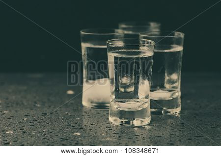 A Glass Of Vodka On The Black Table