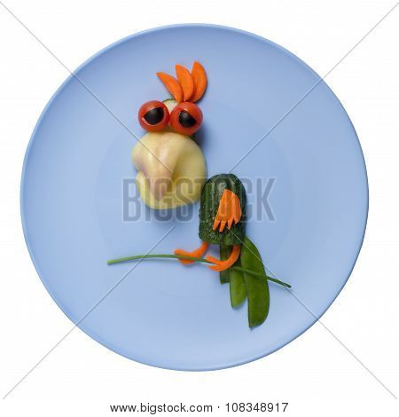 Parrot Made Of Vegetables On Blue Plate