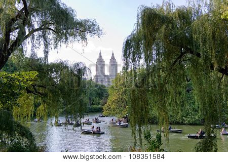 NEW YORK - SEPTEMBER 06: Lake in Central Park Crowded with Small Row Boats and Surrounded by Lush Green Trees with View of San Remo Apartment Building, New York City, New York, USA. September 06 2015.
