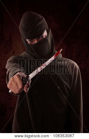 Terrorist Holding A Knife With Blood On It