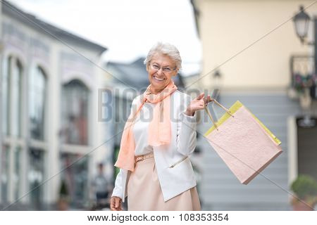 Senior woman with bags in shopping outlets