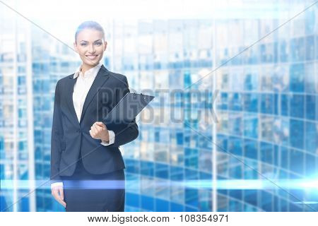 Portrait of business woman handing black documents, blue background. Concept of leadership and success