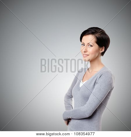 Smiley cheerful woman, on grey background