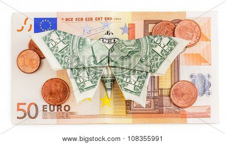 Origami Butterfly Sits On 50 Euro Banknote With Coins Isolated