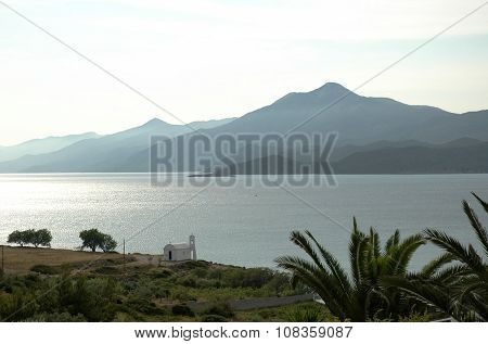 A small white church on the Aegean coast in the morning