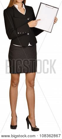 Woman headless showing forefinger on clipboard. white background