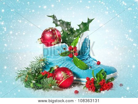 Blue shoe with Holly leaves and berries.