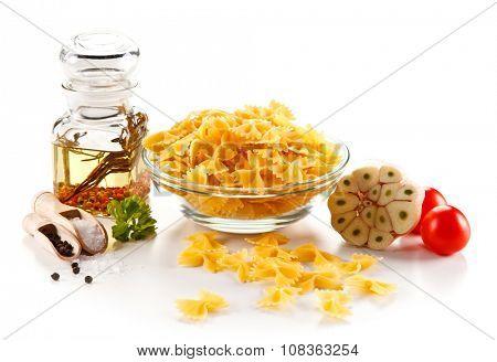Raw pasta on white background