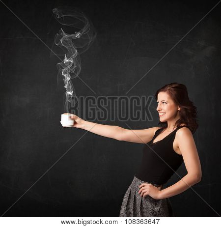 Businesswoman standing and holding a white steamy cup on a black background