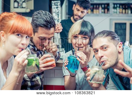 Friends Having Cocktails In A Bar