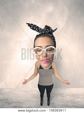 Funny person with big head makes jesting facial expression