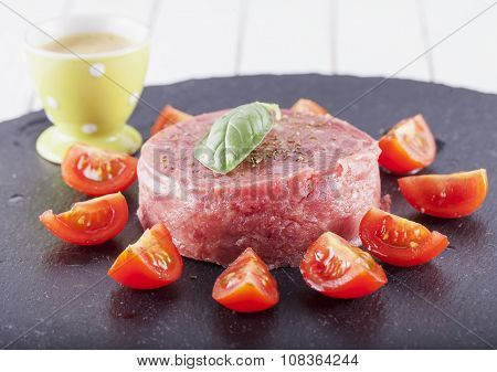 Raw Meat And Tomatoes