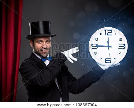 Magician performing a magic trick with clock, playing with time deadline,