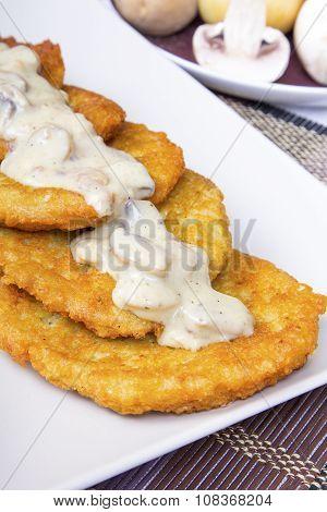 potato pancakes with mushroom sauce