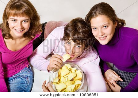 Teens Eating Crisps