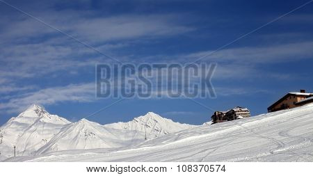Panoramic View On Ski Slope And Hotels In Winter Mountains