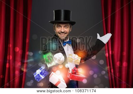 Cheerful magician performs the trick with magic box