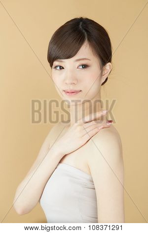 Beautiful asian woman isolated on beige background