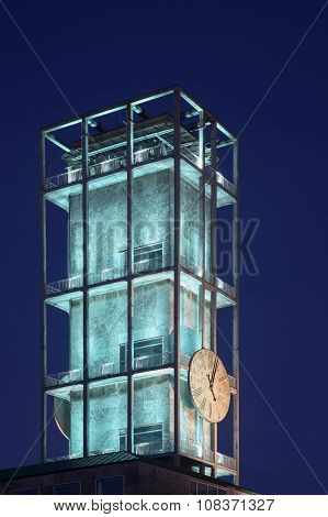Clock of Aarhus city hall at the blue hour