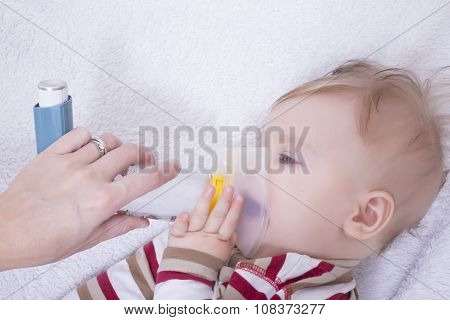 Infant With Asthma Inhalator
