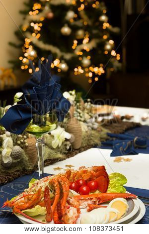 Decorated Christmas dinner table with fresh lobster