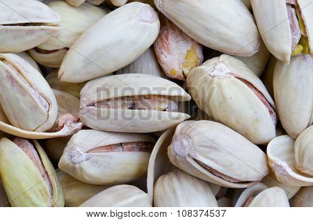 Pistachio nuts with shells. Close up. Background
