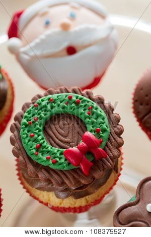 decorative Christmas cupcake wit green-red symbol on top