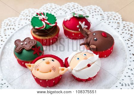 Group of Christmas cupcakes with decorative symbols elements