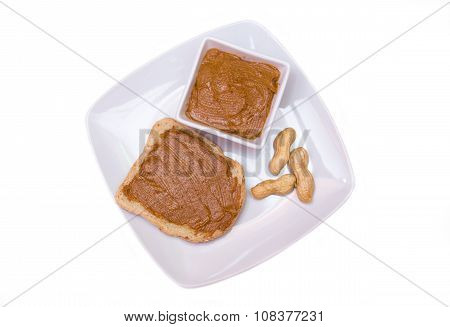 Slice of bread with peanut butter from above