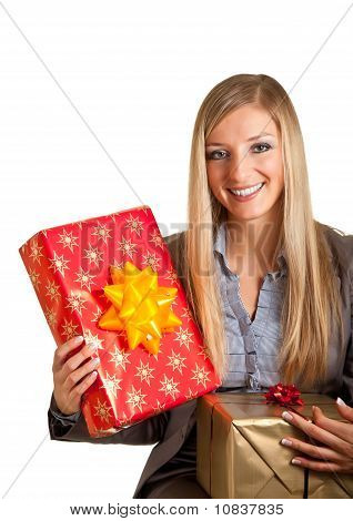 Blond caucasian woman in formal dress with gift boxes isolated on white