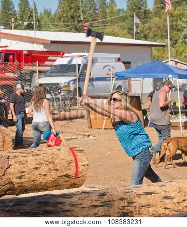 West Point, CA - October 4, 2014 Axe throwing & Chainsaw log cutting competitions at the Lumberjack Day Parade event