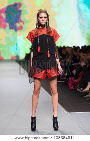 ZAGREB, CROATIA - OCTOBER 31, 2015: Fashion model wearing clothes designed by Ana Maria Ricov on the 'Fashion.hr' fashion show