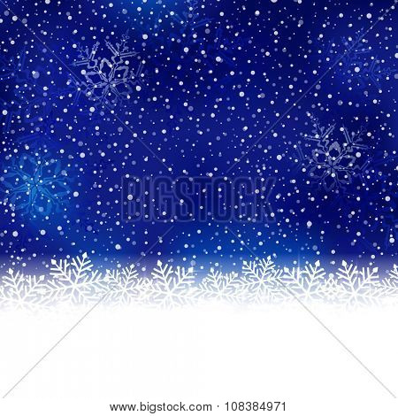 White snow flake border at the bottom of a blue abstract background with blurry light dots and snow fall.