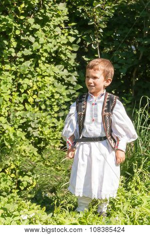 Peasant Child Posing In Traditional Costume