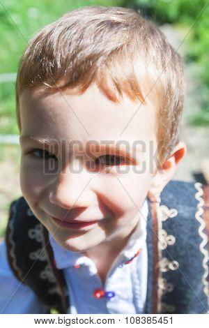 Romanian Peasant Child Having Mood To Play