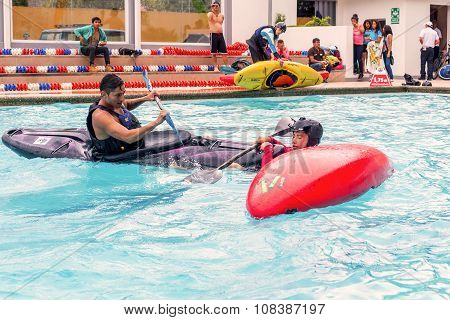 Two Hispanic Men Competes At The Canoeing Contest