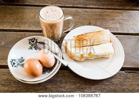 Popular Malaysian Breakfast Teh Tarik, Toast Bread And Half-boiled Egg
