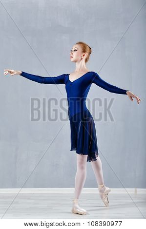 Slim Ballerina In A Blue Dress Dancing.