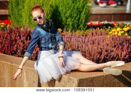 Ballerina Resting In A Park.