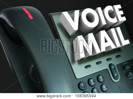 Voice Mail words in white 3d letters on a telephone to illustrate a recorded message or greeting